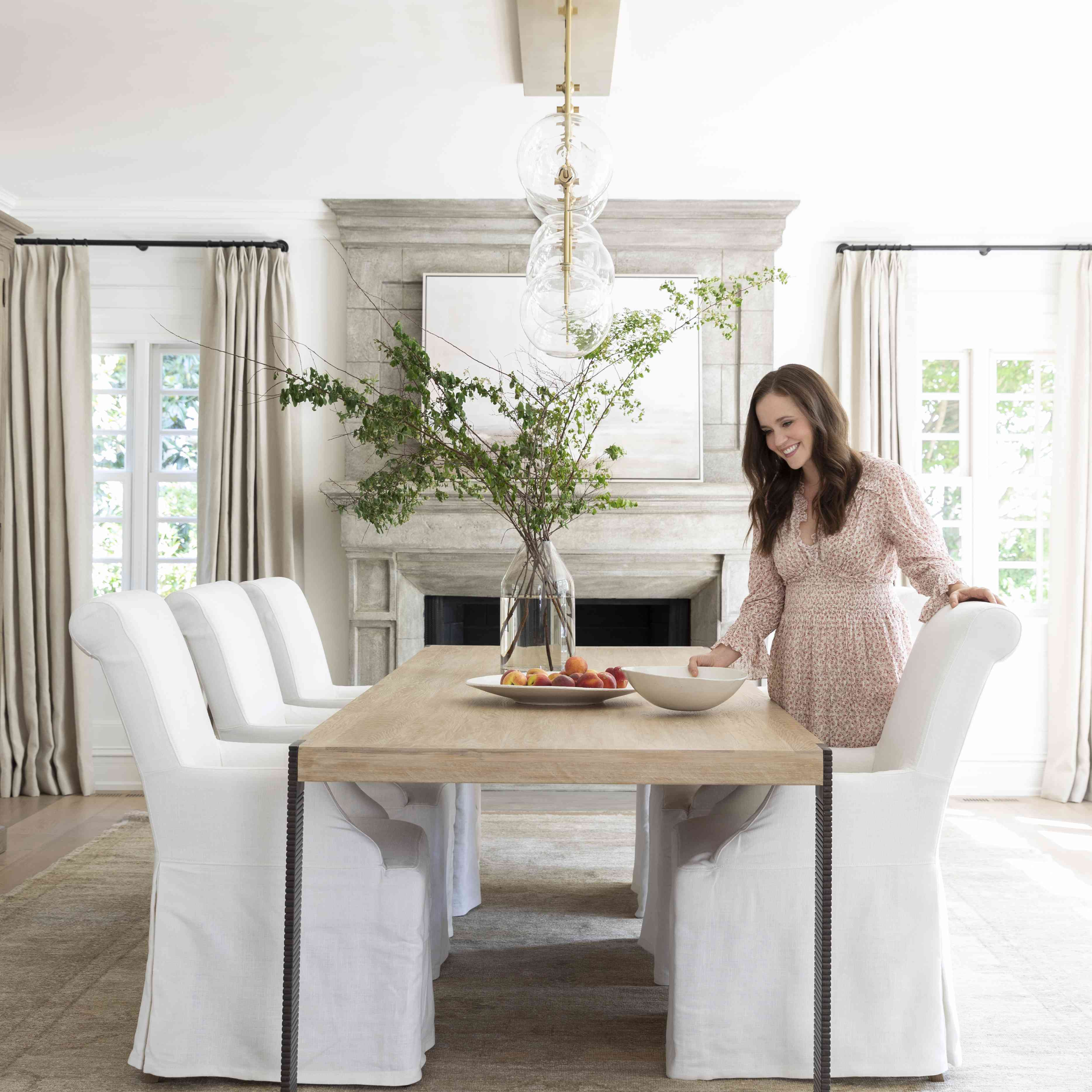 Marie Flanigan poses at a dining table