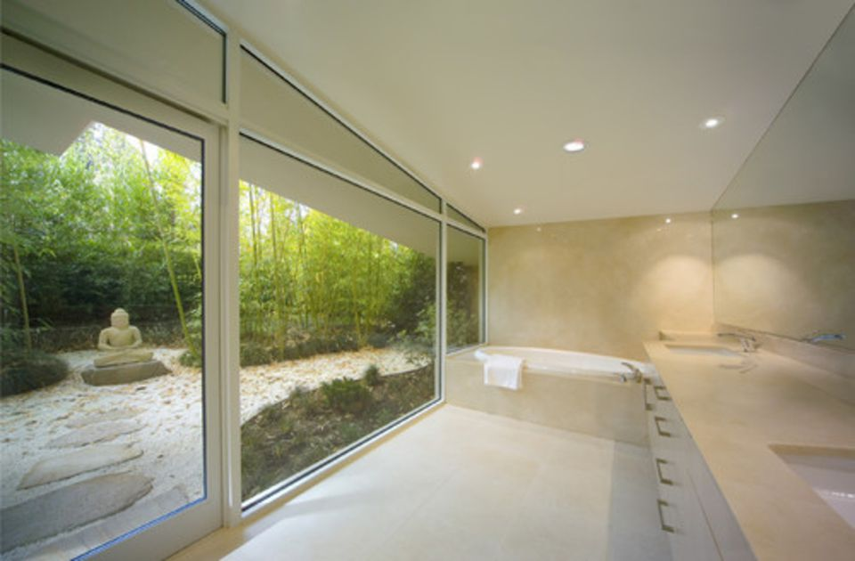 Bathroom with large floor-to-ceiling window and zen garden.