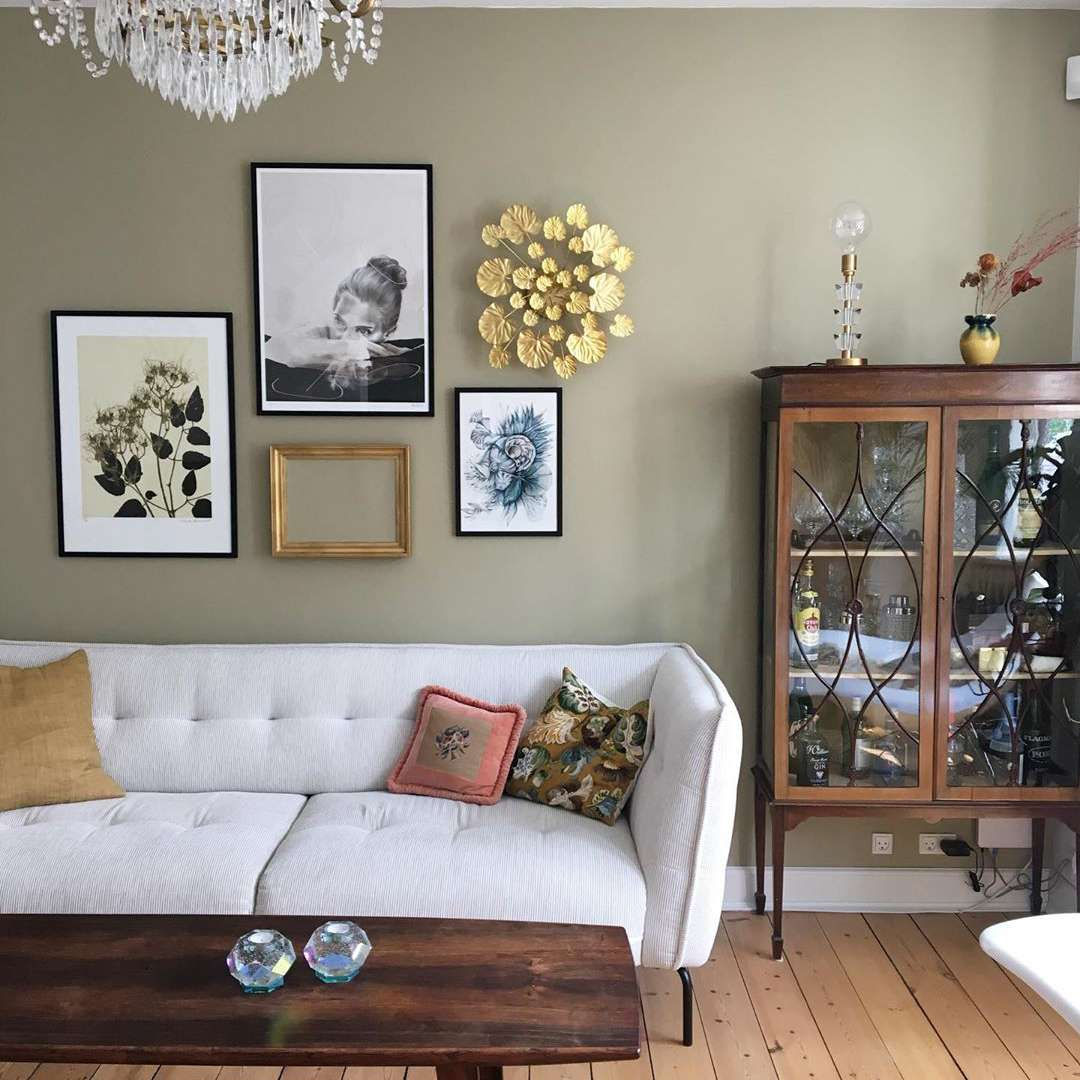 Living room with olive walls and wooden furniture