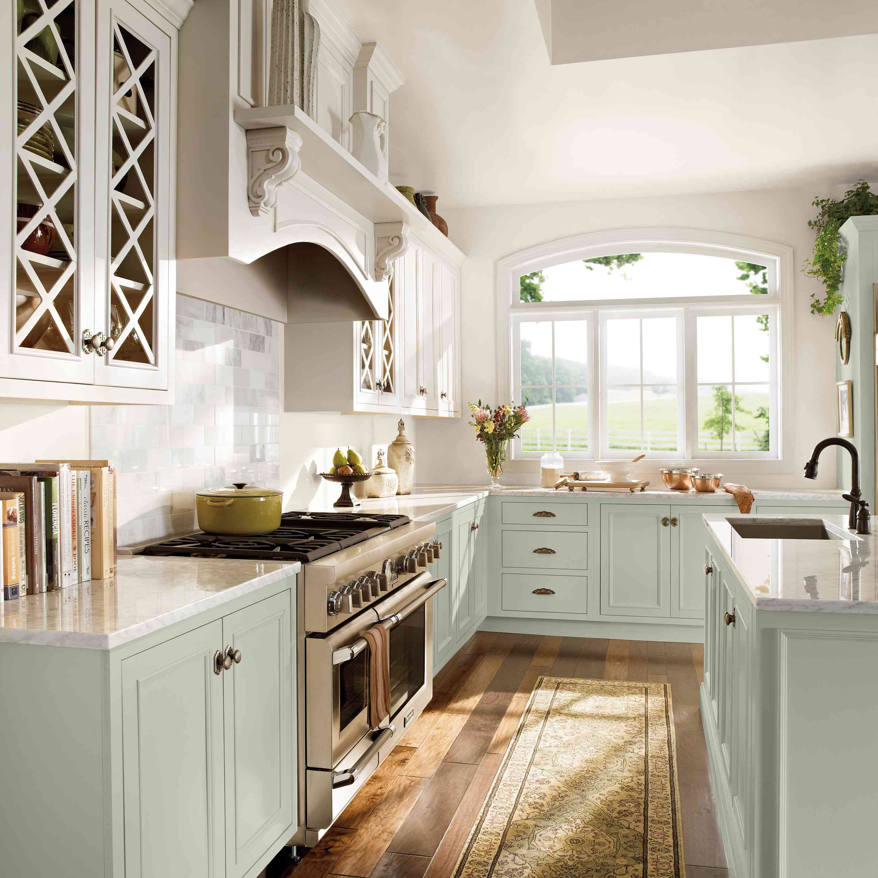 lower cabinets are a mint color in this traditional kitchen