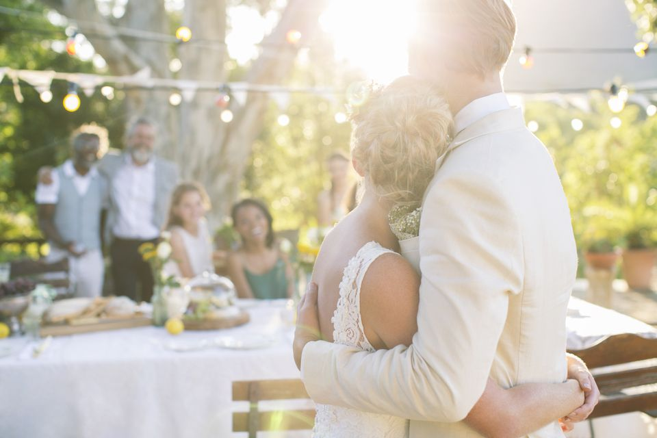 Bride and groom embracing at wedding reception