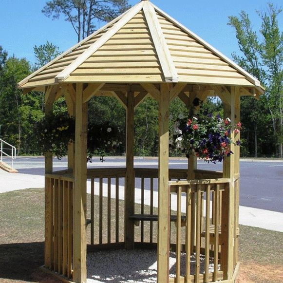 A Wooden Gazebo In A Park