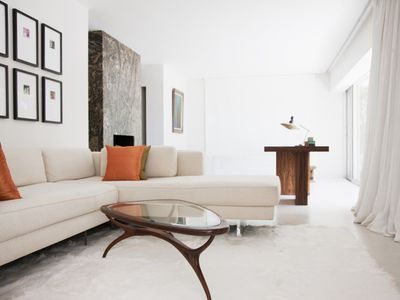 A living room with an accent table