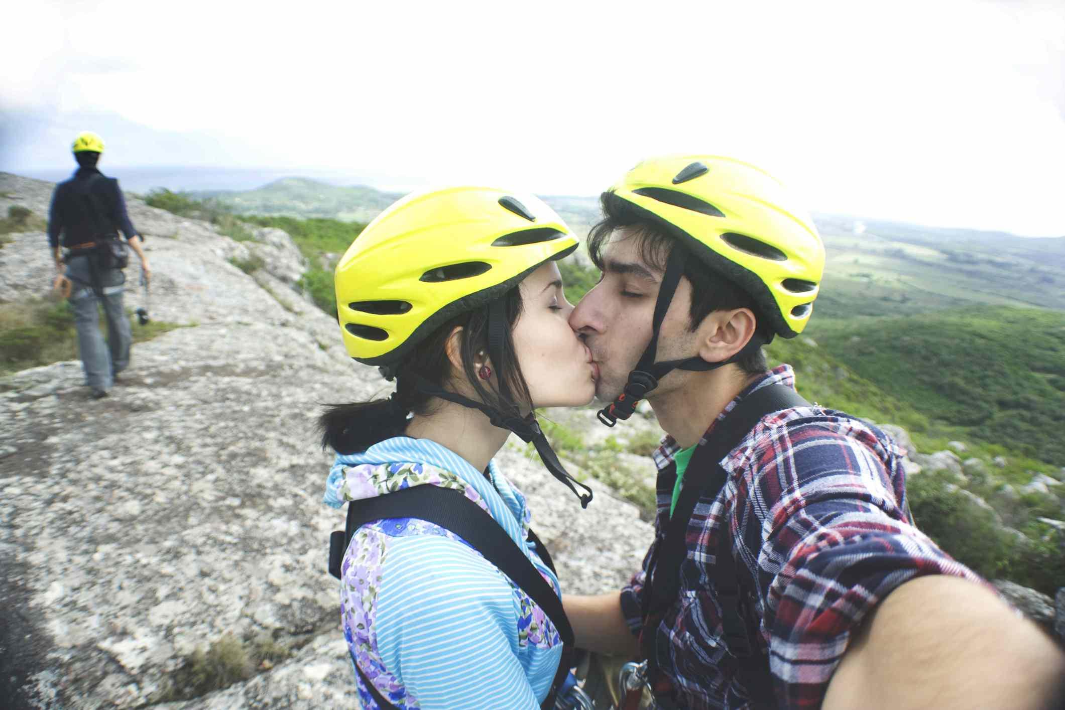 Couple on an adventure wearing helmets