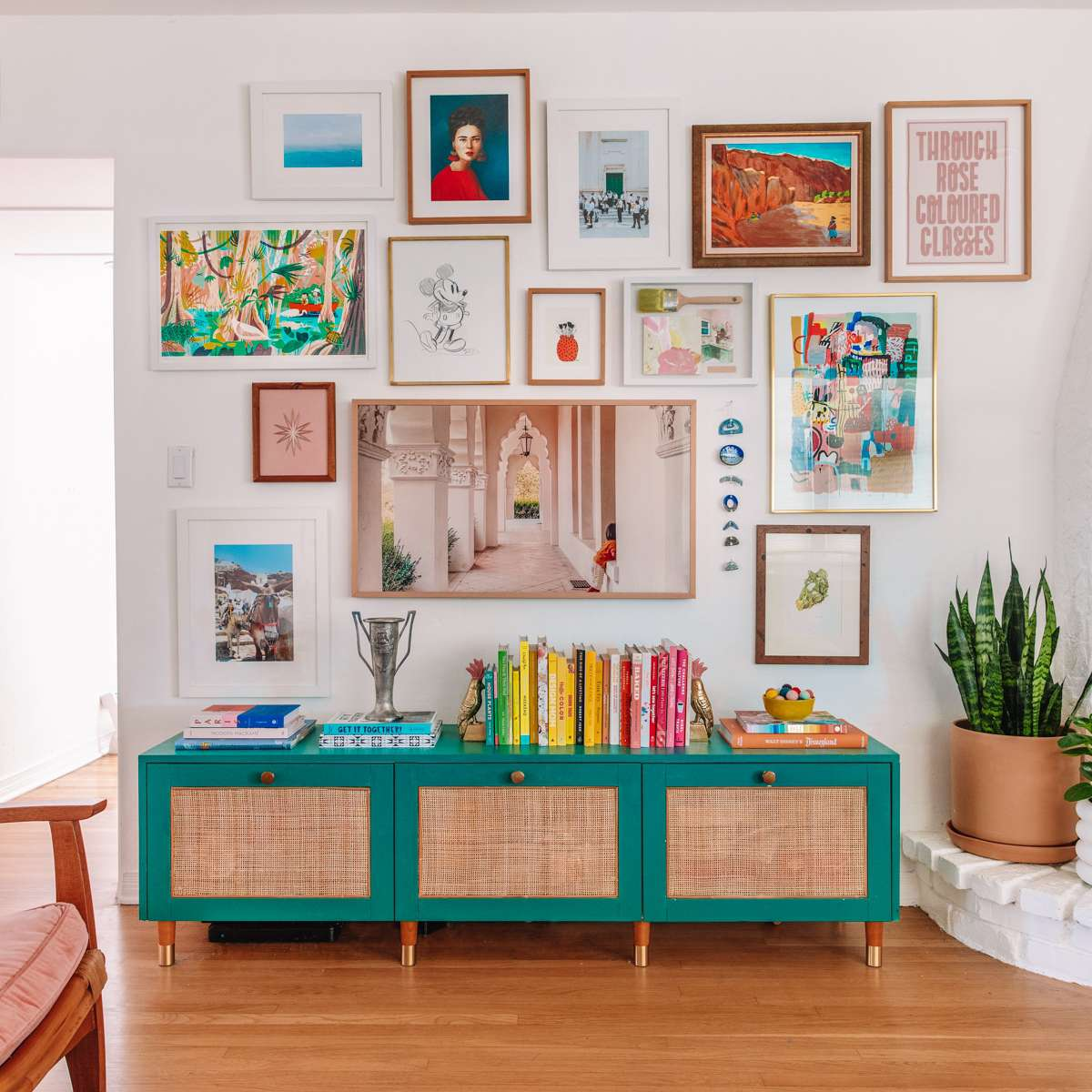 gallery wall above media console