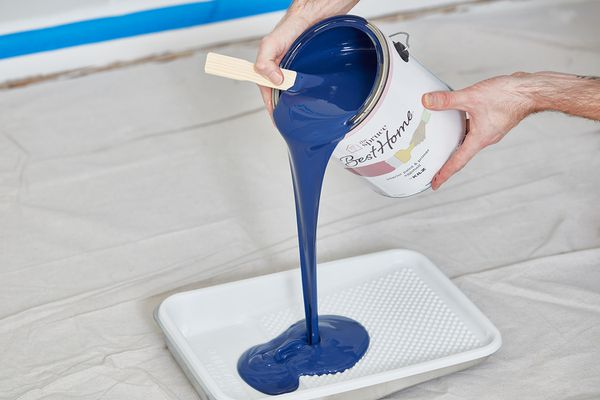 Pouring paint into tray