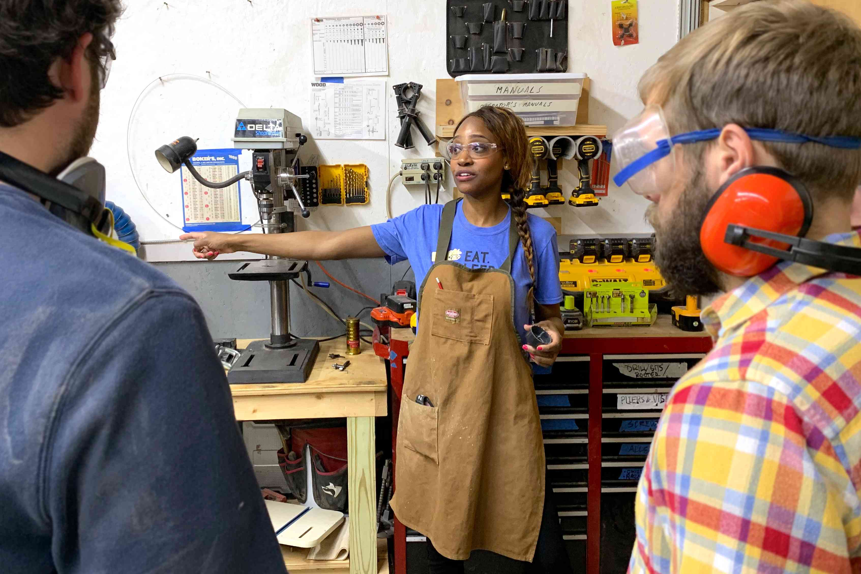 Char Miller-King teaches a woodworking class. girls who build feature