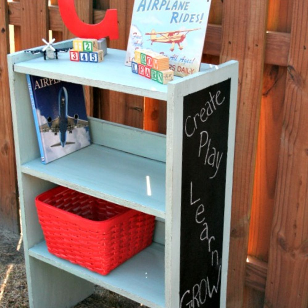 Kid's bookcase makeover with chalkboard sides.
