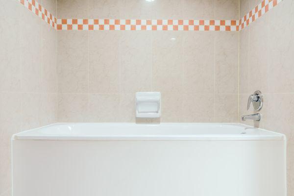 Bathtub and checkered wall trim