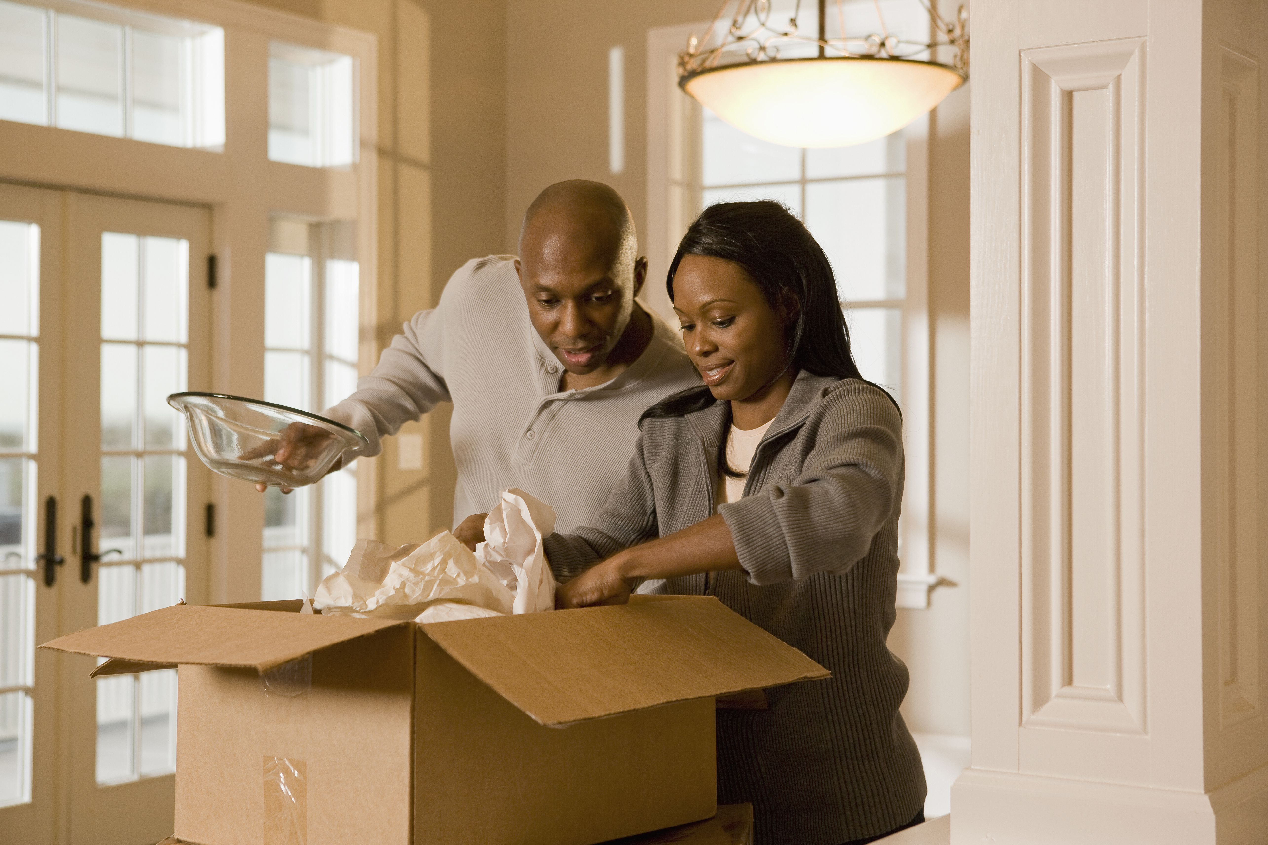African couple unpacking box