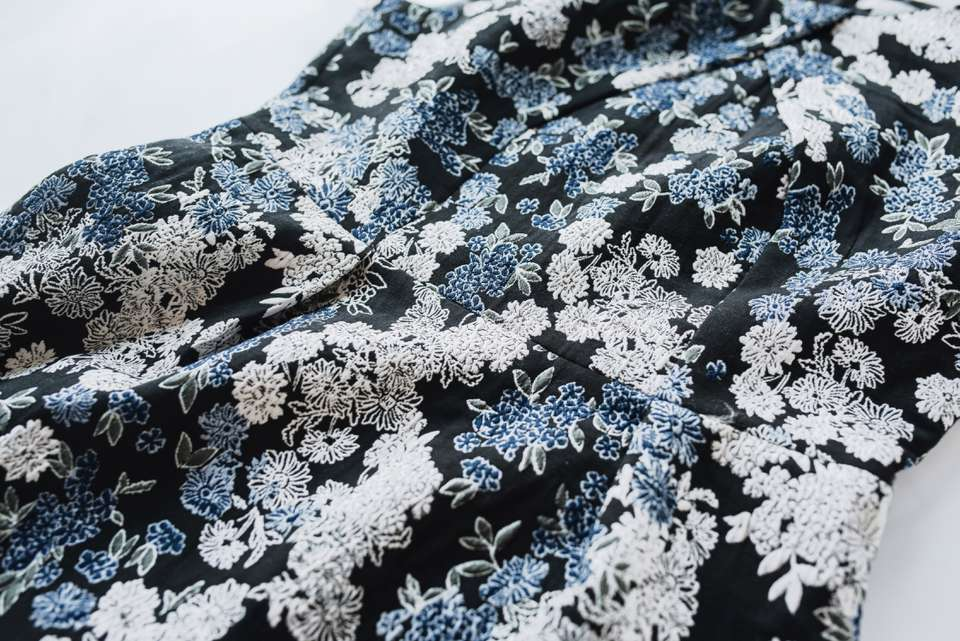 Black and blue brocade fabric dress with floral design