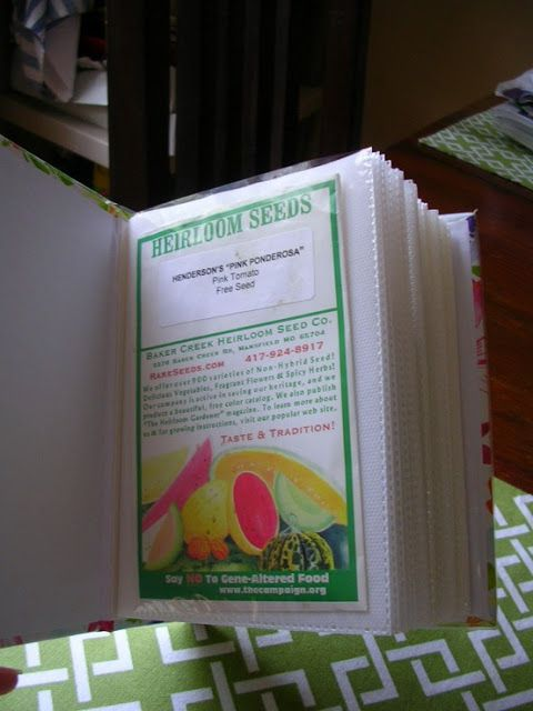 Use a photo album to store and organize seeds