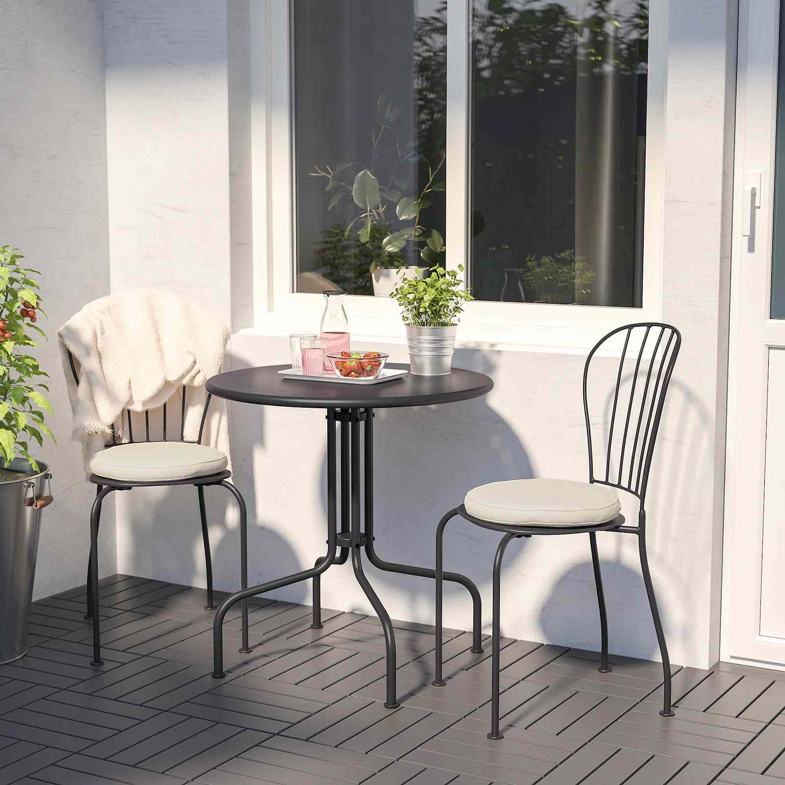 IKEA LÄCKÖ patio table and two chairs