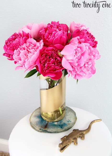 gold vase with flowers