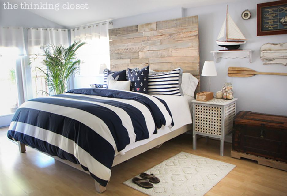 A bed with a blue and white striped cover