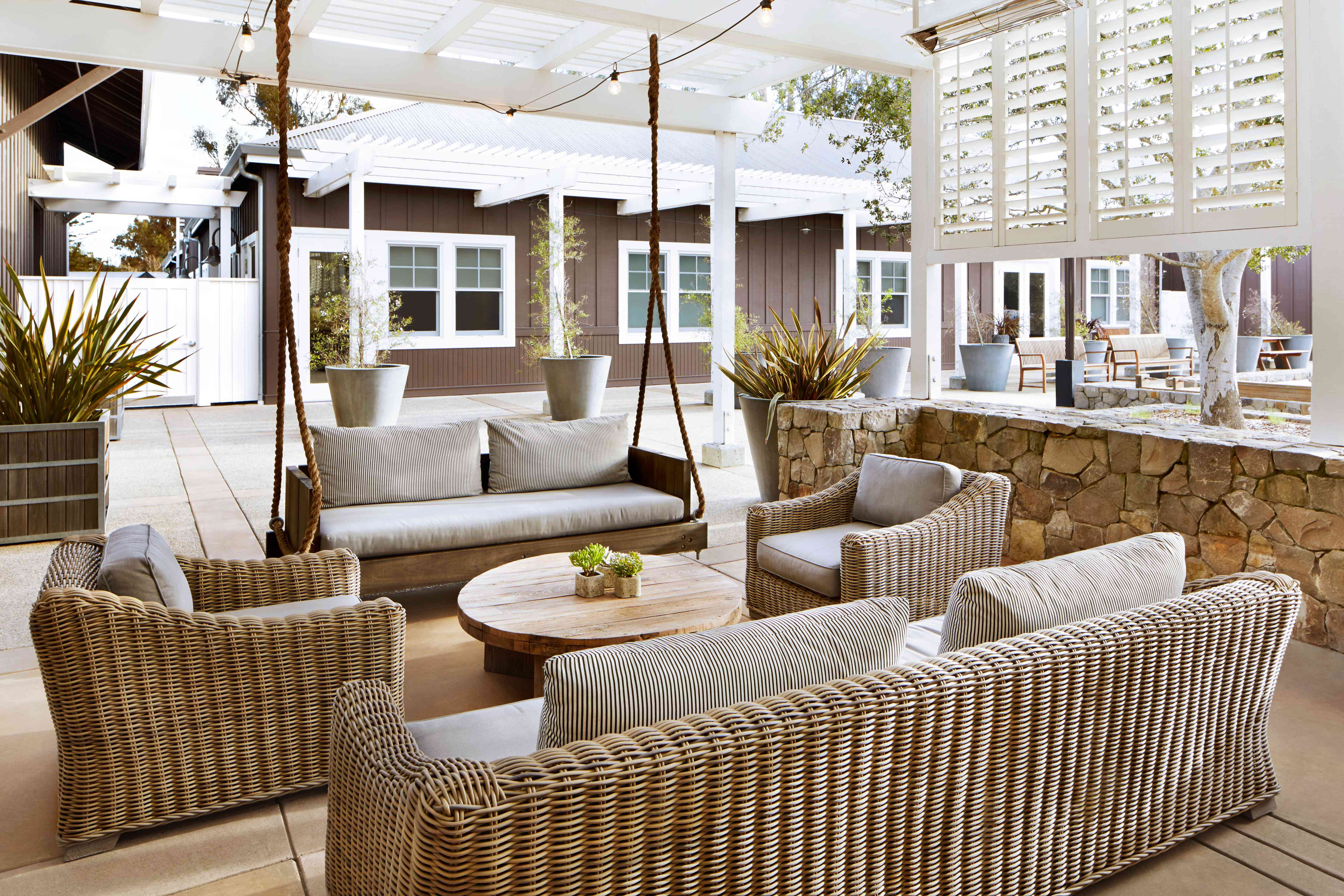 wicker and reclaimed wood furniture on a patio