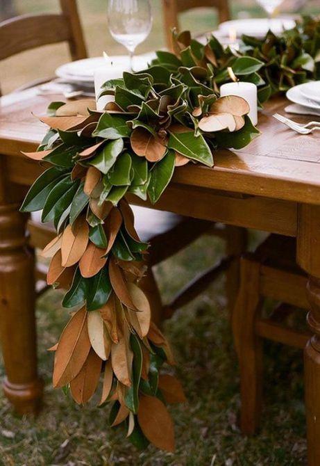 Centro de mesa de boda de primavera de guirnalda de hojas de magnolia