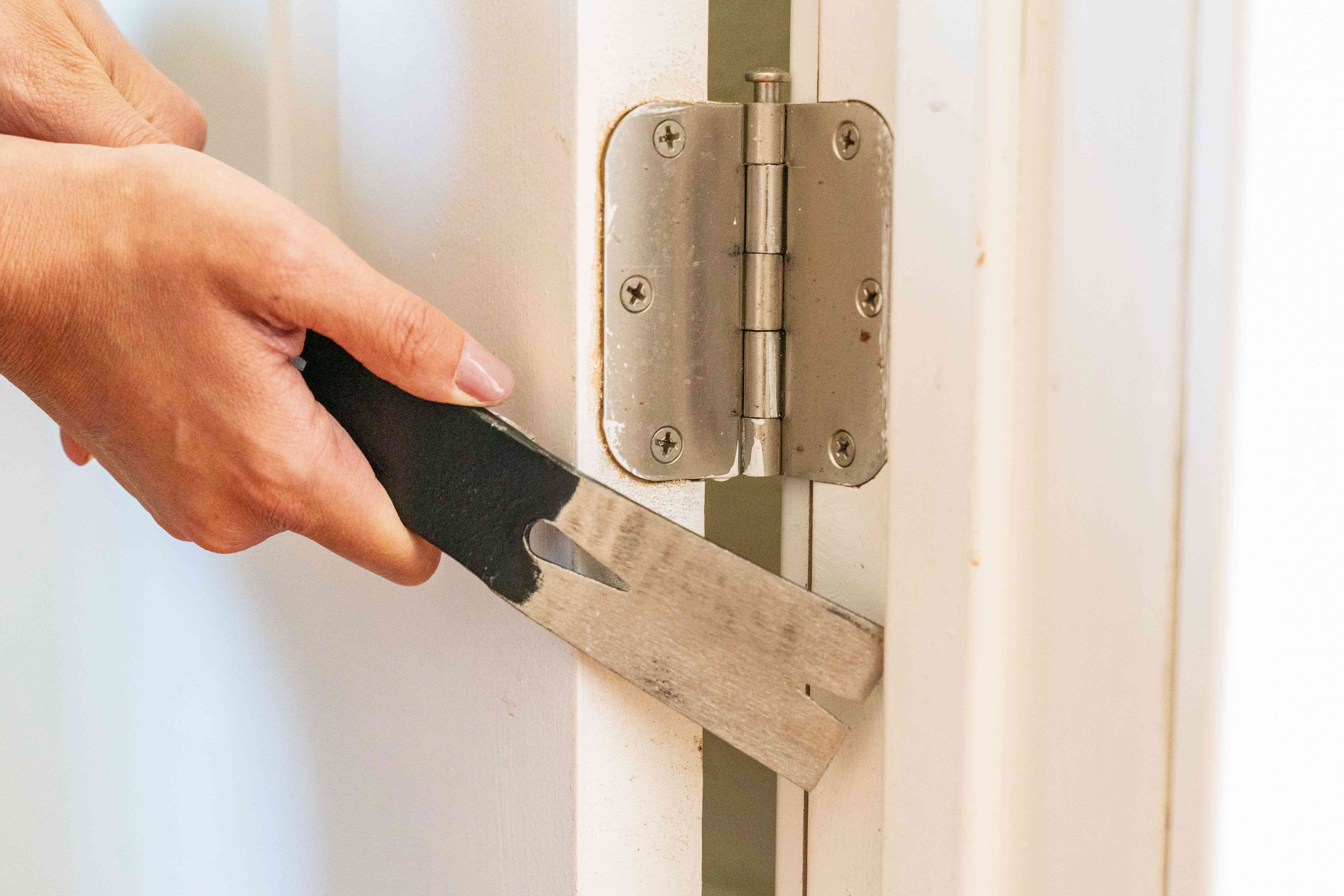 Door jamb adjusted with thin pry bar to fix door that sticks