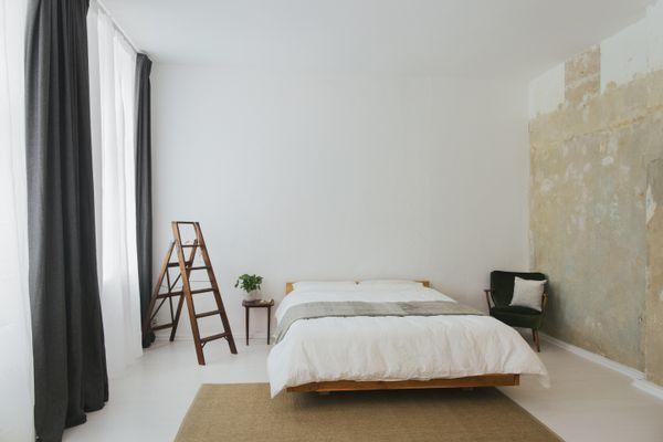 Bedroom with floating bed frame