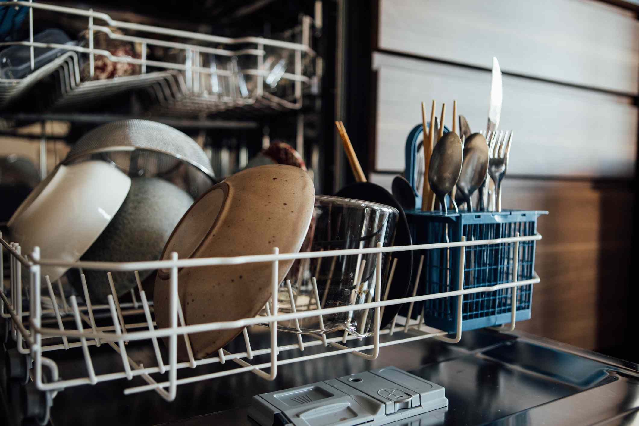 A closeup of the bottom rack of a dishwasher