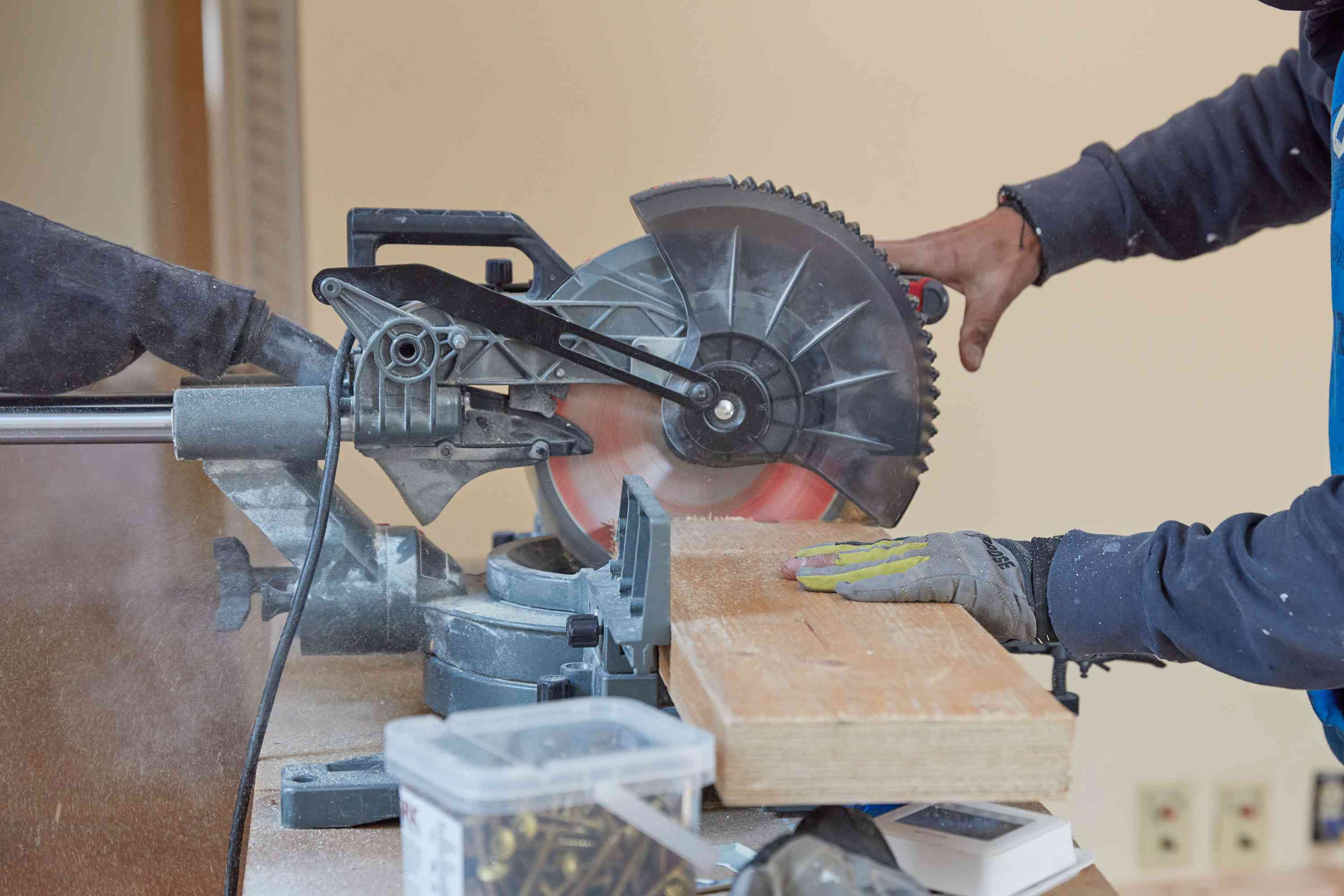Wooden support beam cut by power miter saw