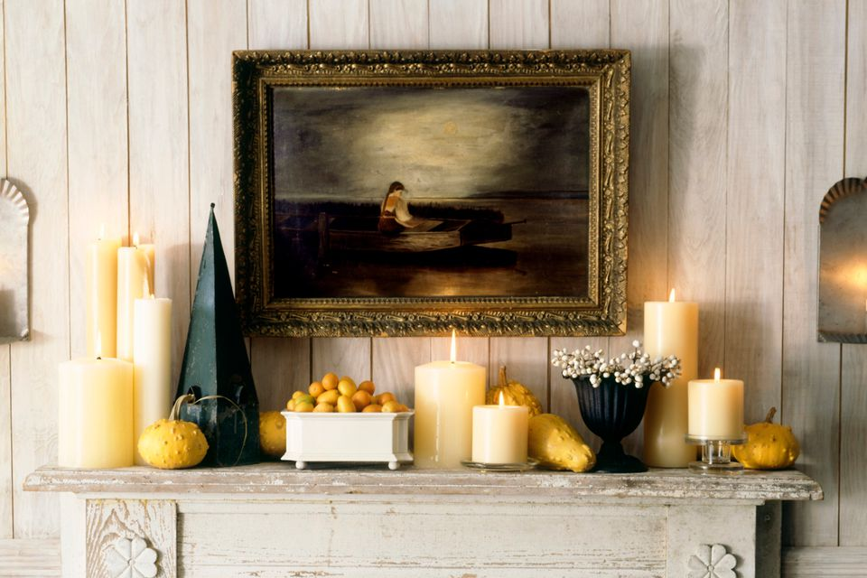 An original painting over the mantel looks far better than a cheap reproduction print.