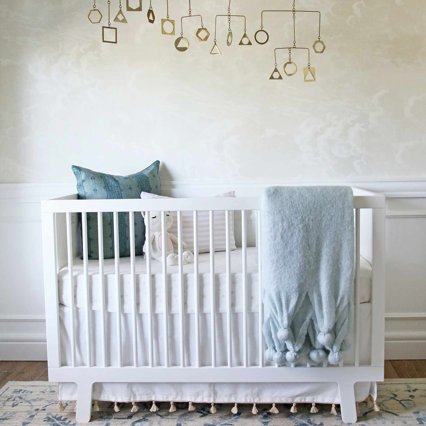 Cream, white, blue modern nursery