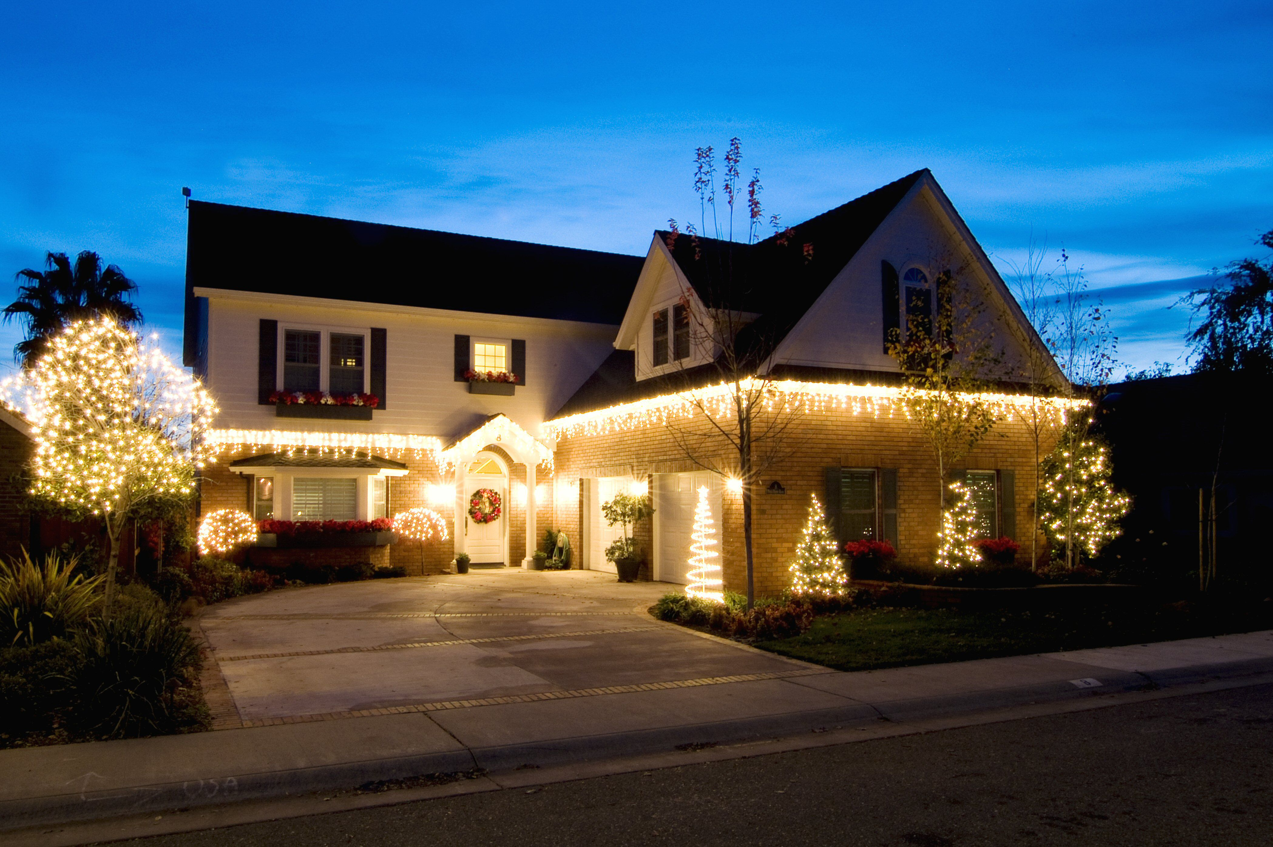 white lights only on the first story of an L-shaped home