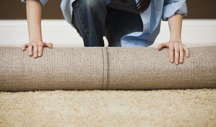 Woman Unrolling Carpet