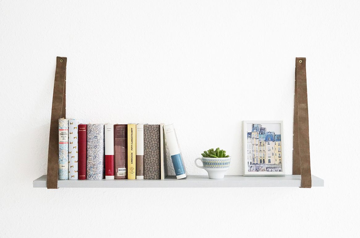 Hanging shelf with books