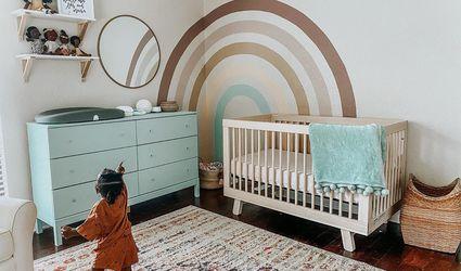 Nursery with a teal and rainbow theme