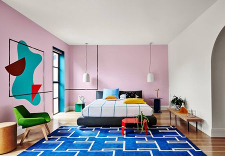 Brightly Colored Living Room With Light Purple Walls And Blue Geometric Rug