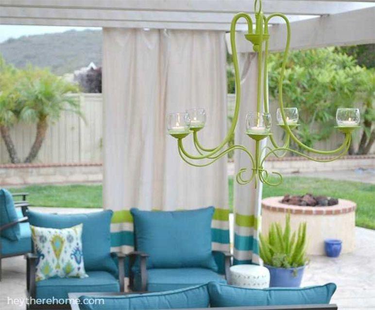 A green outdoor chandelier