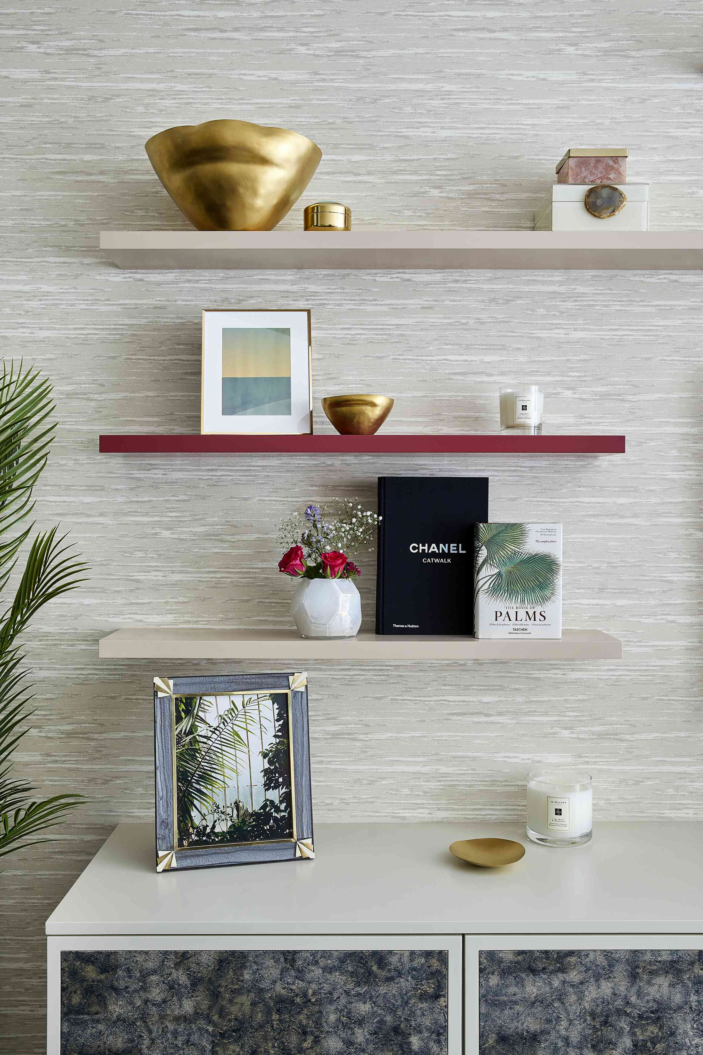 a trio of styled shelves follow the triangle rule