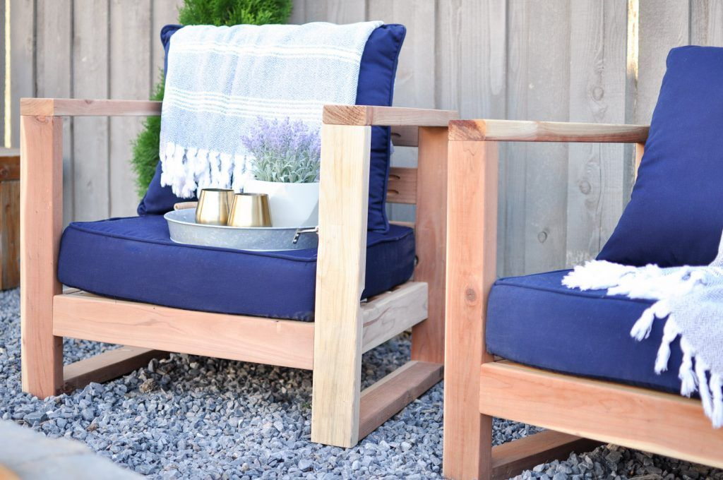 Two outdoor chairs with blue cushions