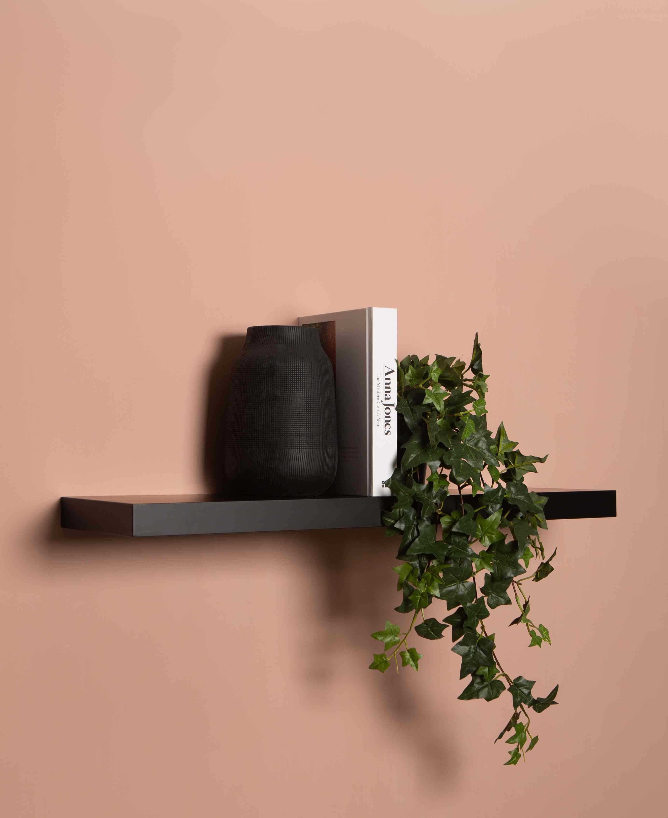 styled floating shelf follows the triangle rule