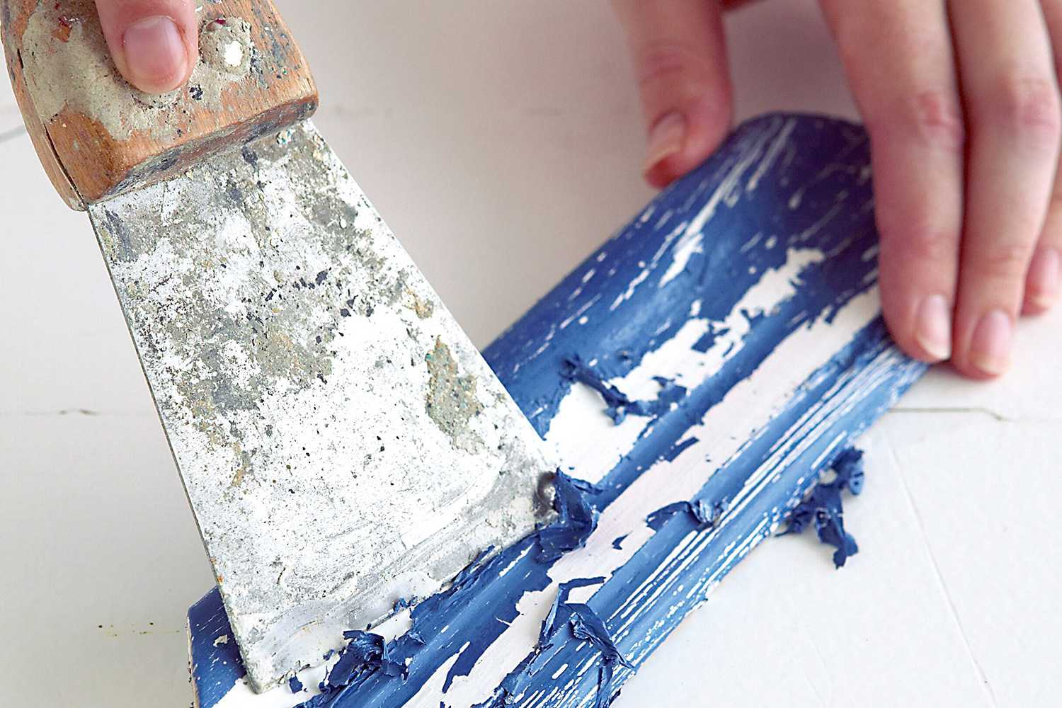 Putty knife scraping paint