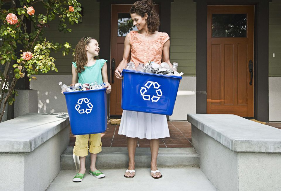 Mother and daughter recycling