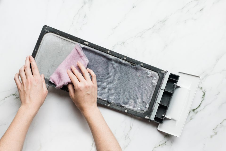 Lint being removed from laundry dryer filter