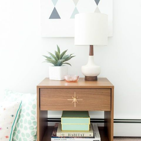 End table with a starburst drawer pull