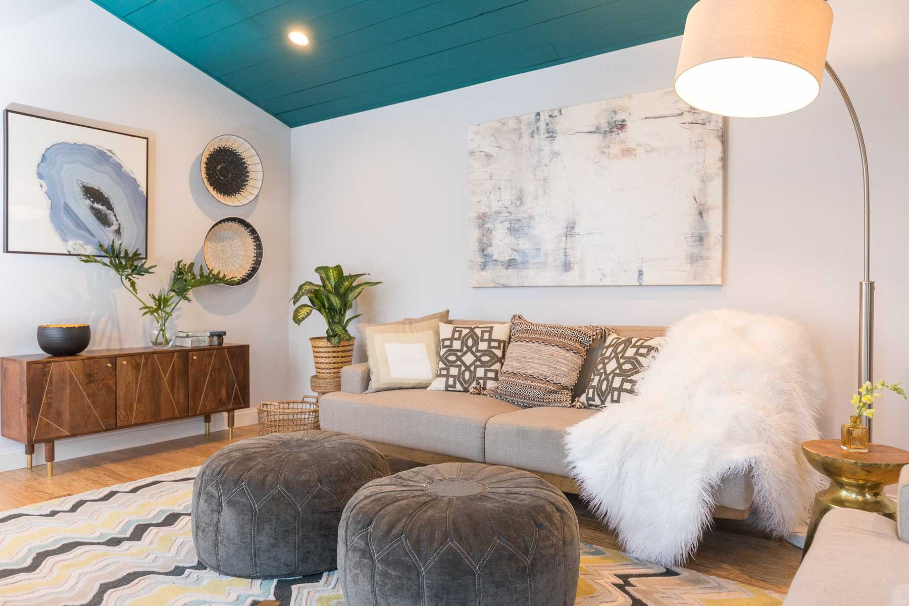 Teal shiplap ceiling in scandi inspired living room