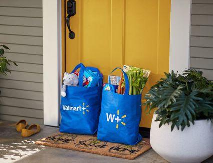Walmart+ bags on front door
