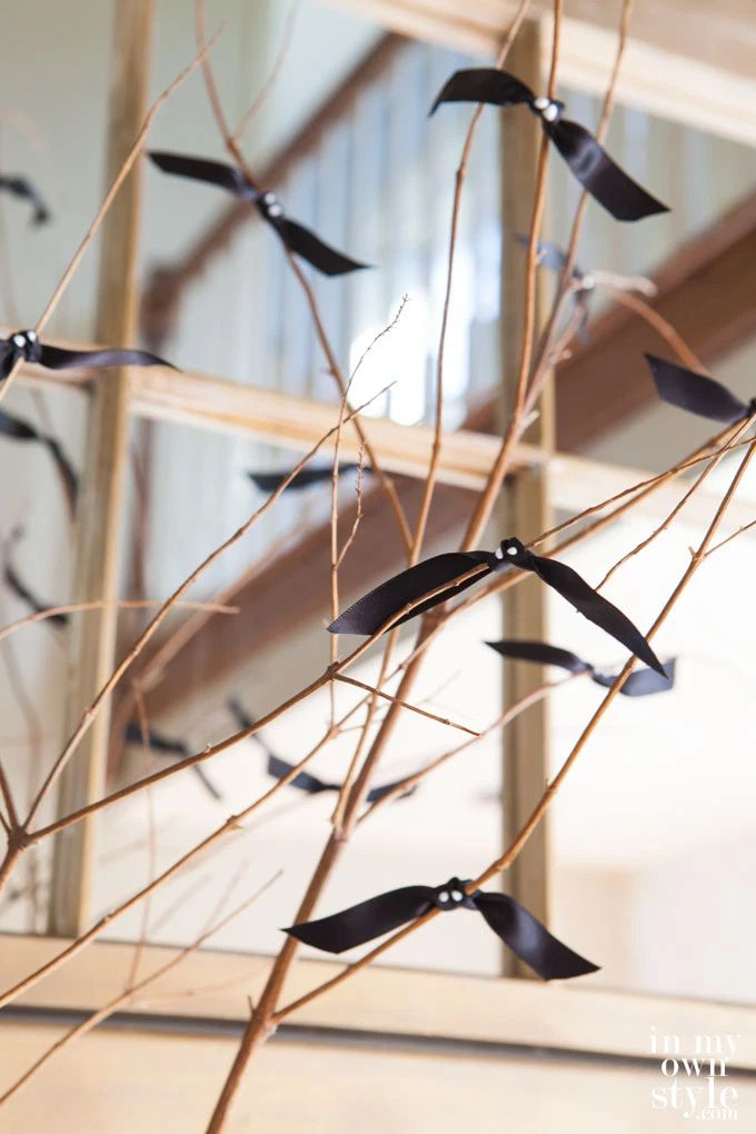 Wooden branches with black bats tied on them