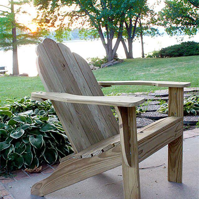 An Adirondack chair sitting on a patio