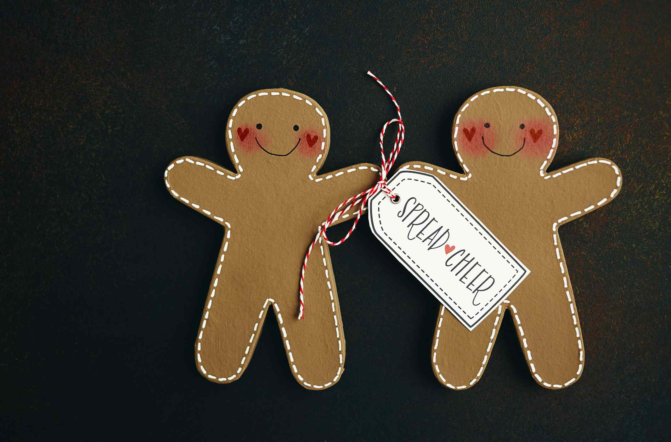 Handmade gingerbread couple with holiday message