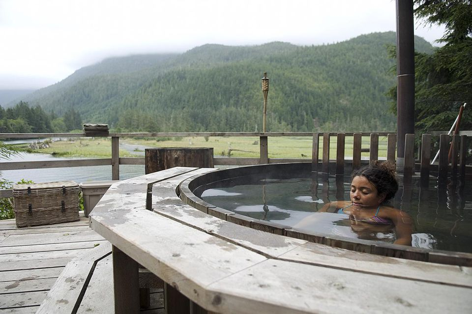 Woman in plunge pool outside in front of mountains