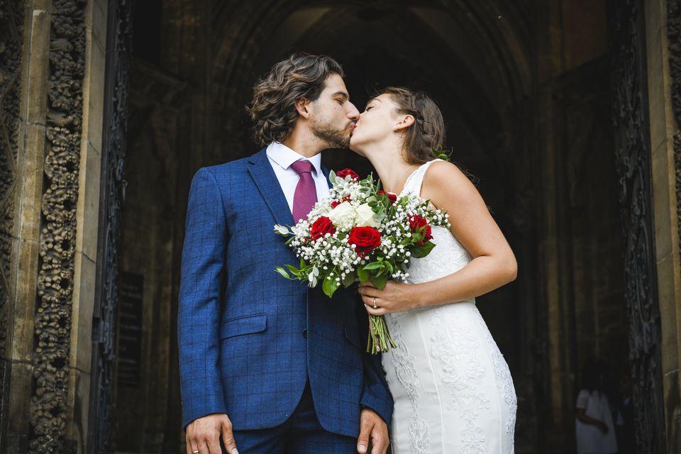 Newlyweds on church steps