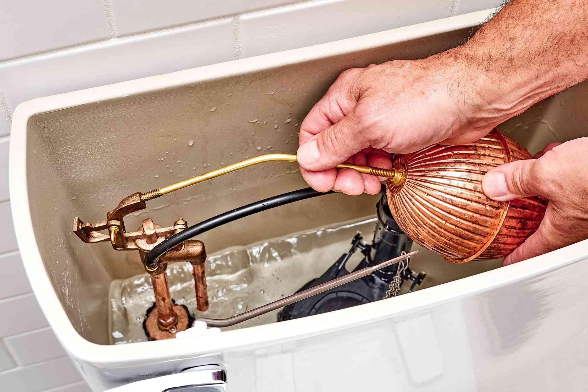 Float rod gently bent to adjust water level in toilet tank