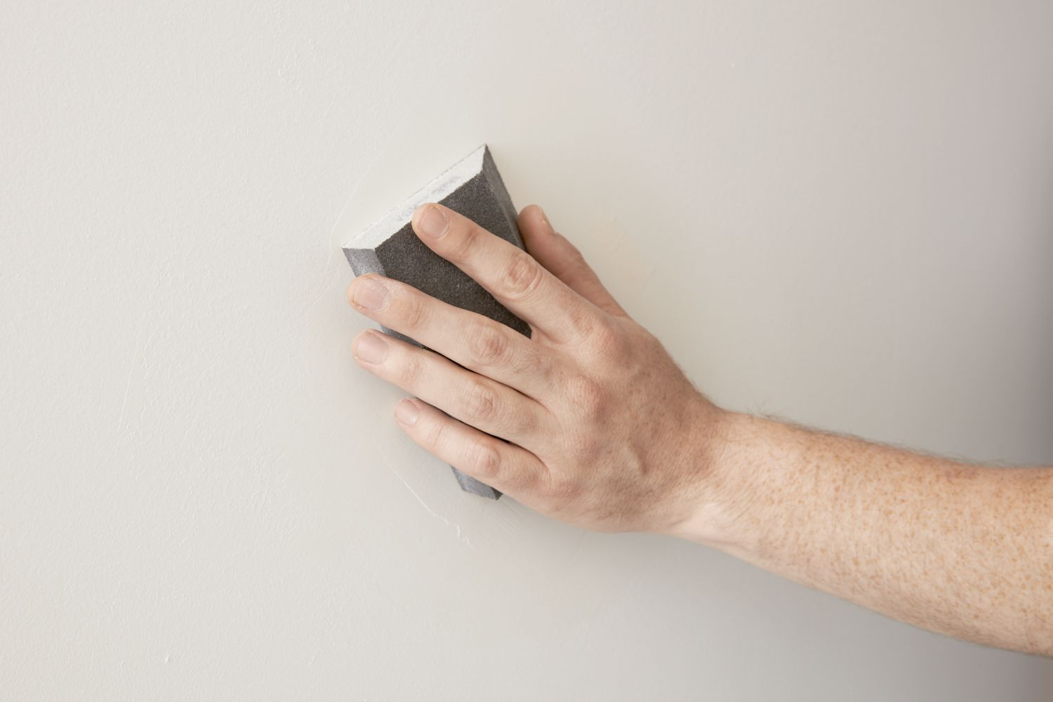 sanding the drywall patch