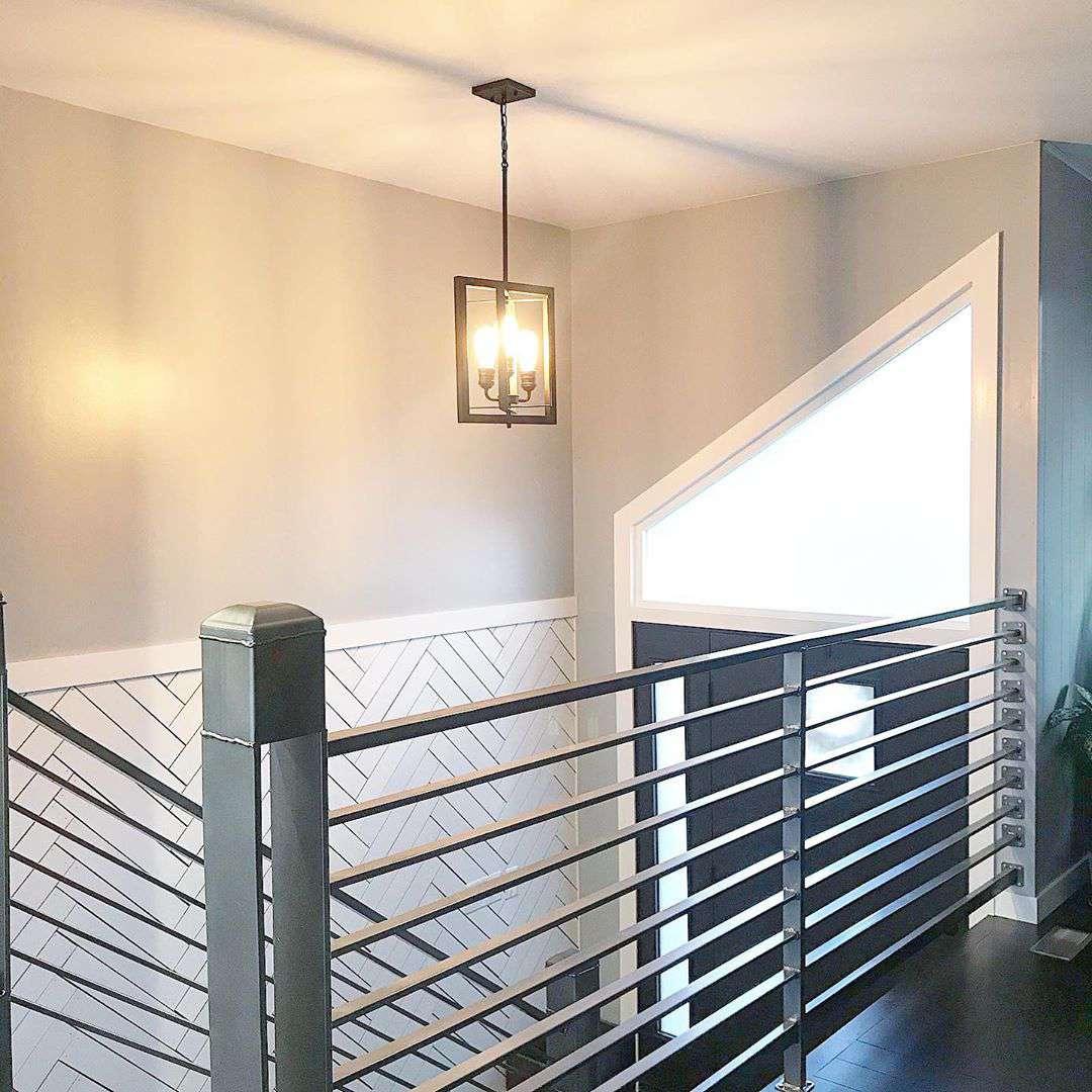 Wall with white chevron strip paneling